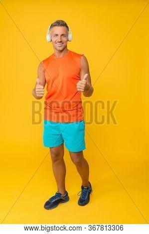 Enjoy Workout Routine. Sportsman Give Thumbs Ups Listening To Music. Using Motivation To Enjoy Exerc