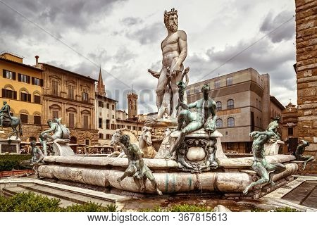 Fountain Of Neptune With Statues On Piazza Della Signoria, Florence, Italy. It Is Tourist Attraction