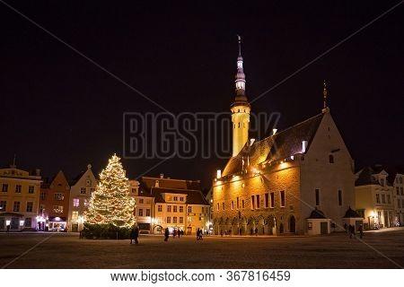 Tallinn, Estonia - January 12, 2018: Night View Of The Christmas Tree Near Medieval The Tallinn Town