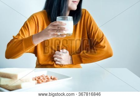 Woman Having A Stomach Pain With A Glass Of Milk At Home,allergy Dairy Intolerant,lactose Intoleranc