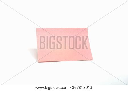 Isolated Single Pink Notepad Paper On White Background.