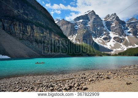 Moraine Lake Is A Glacially Fed Lake In Banff National Park, 14 Kilometres (8.7 Mi) Outside The Vill