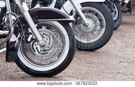 Wheels Of Motorbikes Standing In A Row Close Up