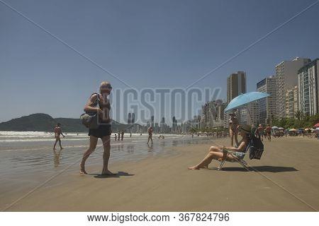 Balneario Camboriu, Santa Catarina, Brazil - November 18, 2016: Senior People Enjoying The Beach In