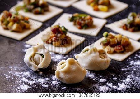 Homemade Asian Dumplings With Vegetable Filling On A Black Granite Table, Chinese Dumplings For Dinn