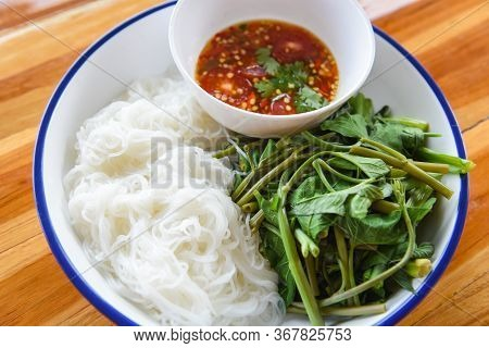 Thai Food Top View Rice Noodles With Chilli Sauce Spicy Served On Plate / Rice Vermicelli And Vegeta