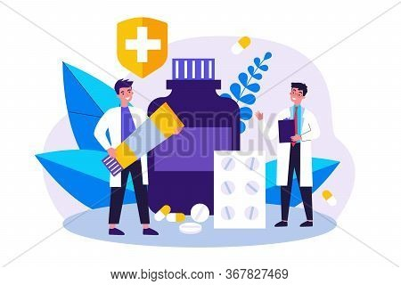 Doctor With Prescription And Pharmacist With Ointment Tube Discussing Treatment, Pills And Drug In D