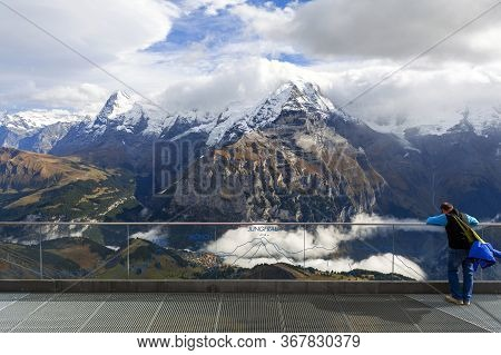 Lauterbrunnen, Switzerland - October 2019: A Tourist At The Viewpoint Deck Located At Birg Cableway