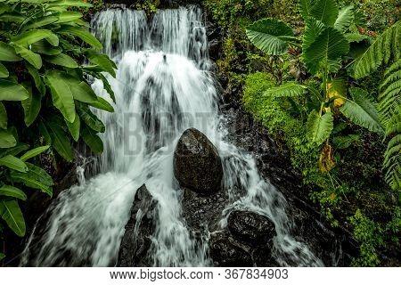 Waterfall Landscape. Beautiful Hidden Waterfall In Tropical Rainforest. Jungle River. Adventure And