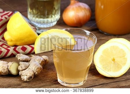 Hot Tea Against Cough And Flu Made From Onion, Ginger, Lemon And Honey. Homemade Tea From Raw Cut On