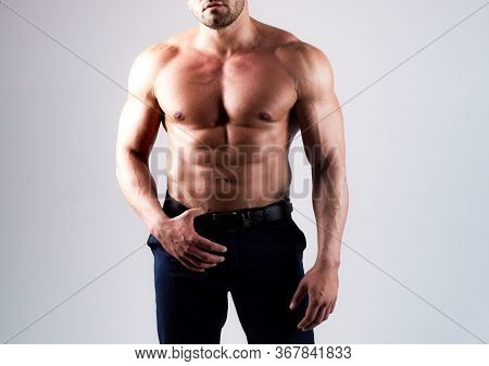 Strong Man Or Muscular Men. Bare Torso. Young Mans Naked Body On Gray Isolated Background. Metrosexu