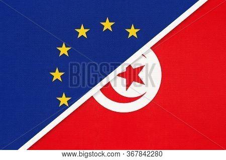 European Union Or Eu And Tunisia National Flag From Textile. Symbol Of The Council Of Europe Associa