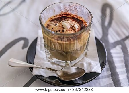Affogato Coffee - A Shot Of Hot Espresso Poured Over Vanilla Ice Cream Decorated With Cocoa Powder I