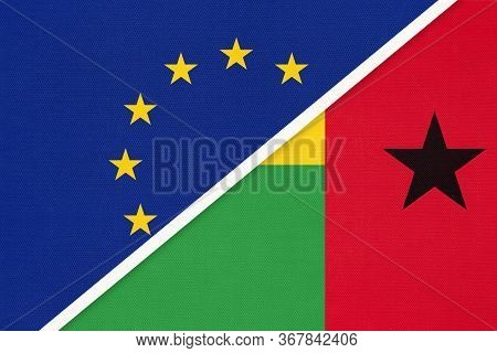 European Union Or Eu And Guinea-bissau National Flag From Textile. Symbol Of The Council Of Europe A