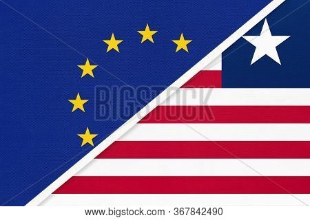 European Union Or Eu And Liberia National Flag From Textile. Symbol Of The Council Of Europe Associa