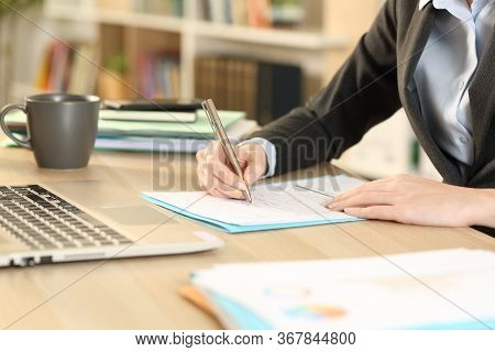 Close Up Of Self Employed Woman Hands Filling Out Checkbox Form Sitting On A Desk At Homeoffice