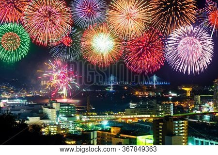 Aerial Night View Of Nagasaki, Japan With Fireworks Over The Entire Center