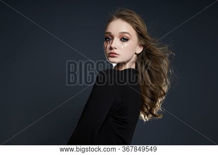Beauty Portrait Of A Girl With Creative Makeup, A Woman Crying With Mascara Made Of Sequins. Fashion