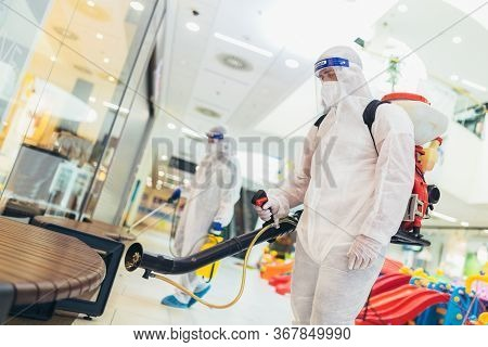 Professional Workers In Hazmat Suits Disinfecting Indoor Of Mall, Pandemic Health Risk, Coronavirus