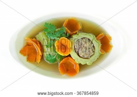Stuffed Bitter Gourd In Clear Soup With Carved Carrots Flower Shape
