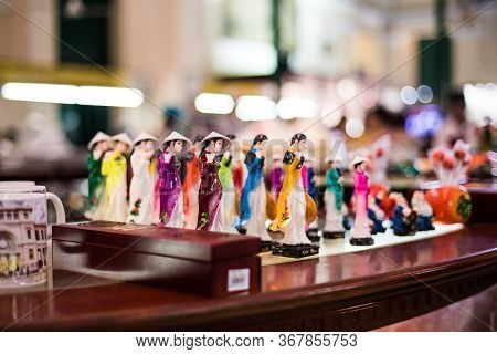 Ho Chi Minh City, Vietnam, April 22 2016.dolls Wearing Ao Dai, Which Are On Sale For Tourists At Sai