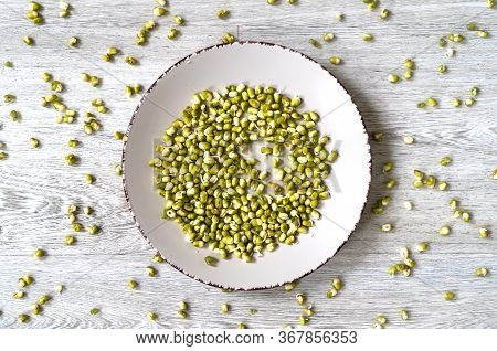 Green Mung Beans (vigna Radiata) Are On A Plate. The View From The Top. Mung Bean Sprouts Close-up.