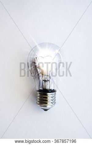 Lightbulb On White Background, Illuminated Light Bulb, Macro Of Electric Bulb