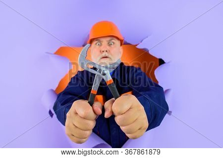 Professional Plumber Holds Pliers. Auto Mechanic Holds Combination Pliers. Builder With Adjustable P