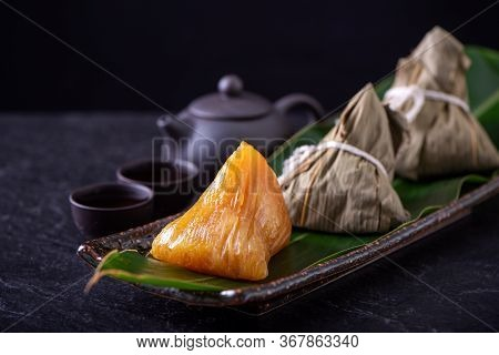 Alkaline Rice Dumpling Zongzi - Traditional Sweet Chinese Crystal Food On A Plate To Eat For Dragon