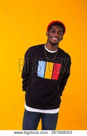 Young Handsome African American Man With An Afro Hairstyle. Portrait On Yellow Background. Guy Looki