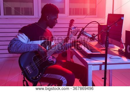 Musician And Making Music Concept - African American Male Sound Producer Working In Recording Studio