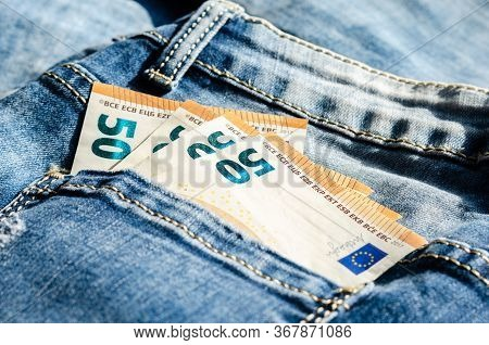 Concept Regarding Savings And Expenses  .50 Euros  In The Back Pocket Of The Pants .