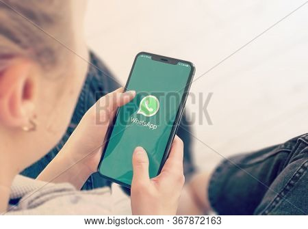 Kyiv, Ukraine-january, 2020: Whatsapp On Cellphone Screen. Young Girl Pointing Or Texting Whatsapp O