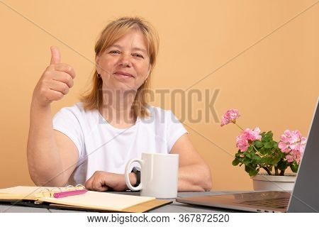Happy Mature Middle Aged Elderly Business Woman Winner Excited By Reading Good News Looking At Lapto