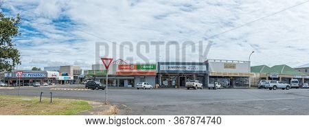 Harrismith, South Africa - March 16, 2020:  A Panoramic Street Scene, With Businesses, Vehicles And