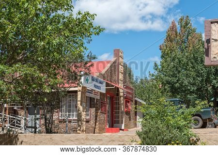 Clarens, South Africa - March 18, 2020:  A Street Scene, With A Medical Centre And Photographer, In