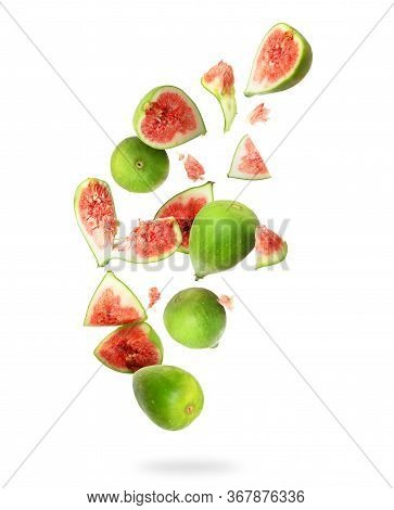 Whole And Sliced Ripe Green Figs In The Air On A White Background
