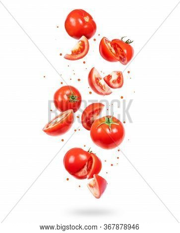 Whole And Sliced Fresh Tomatoes In The Air On A White Background
