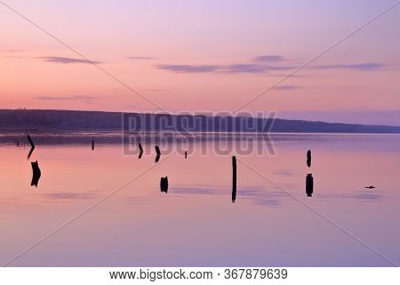 The Photo Was Taken At Sunset Near The Estuary Near The City Of Odessa. The Mirror Image Of The Wate