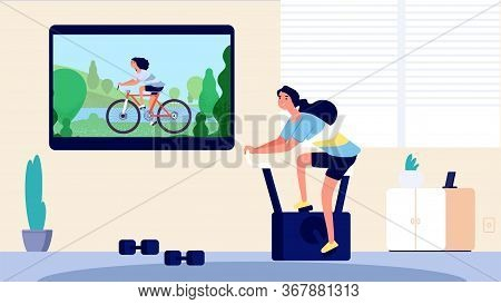 Home Sport. Woman Training In Living Room. Cycling On Tv, Girl On Exercise Bike. Online Video Sports