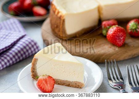 Cheesecake With Strawberries On Plate. Homemade Cheesecake. New York Style Cream Cheese Cake