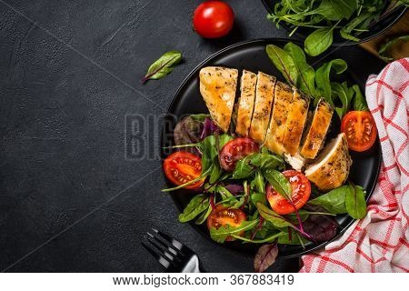 Chicken Fillet With Fresh Salad. Healthy Food, Keto Diet, Diet Lunch Concept. Top View On Black Back