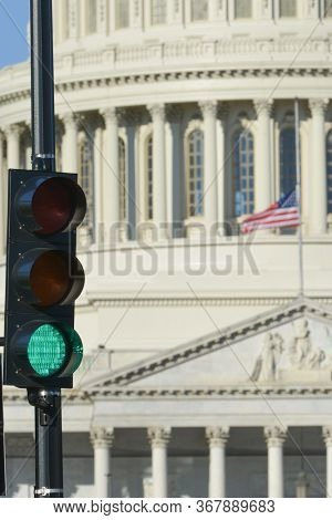 Green traffic light and U.S. Capitol Dome that symbolizes positive political decision -  Washington D.C. United States of America