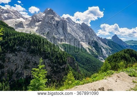 Alpine Landscape In The Dolomites, Italy. Glacier Marmolada And Fedaia Pass.