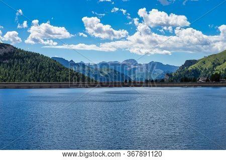 Alpine Landscape In The Dolomites, Italy. Glacier Marmolada And Lago Di Fedaia.