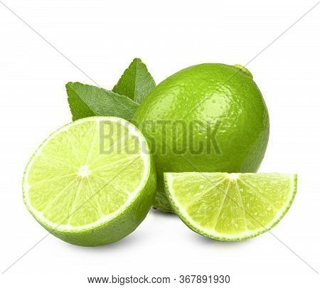 Limes With Slices And Leaves Isolated On White Background  Clipping Path.
