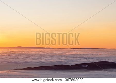 View To Sunrise With Inversion Of The Higest Mountain