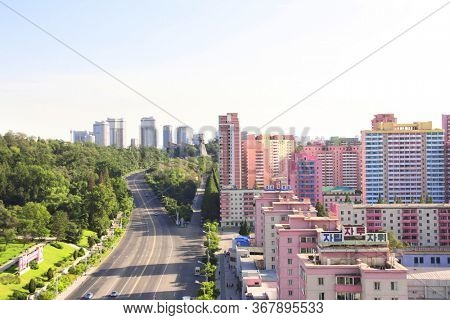 PYONGYANG, NORTH KOREA (DPRK) - SEPTEMBER 14, 2017: Aerial view of new residential complex, winged horse statue Chonllima and Grand Monument Mansudae. View from the of Arch of Triumph
