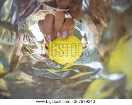 Woman Takes Chips From The Package, Photo From The Package.