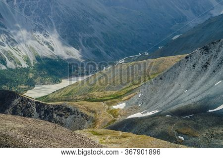 Atmospheric Alpine Landscape With Beautiful Valley With Mountains Lake And Giant Textured Slopes Wit